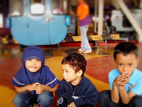 three kids at skylift station ;p.jpg