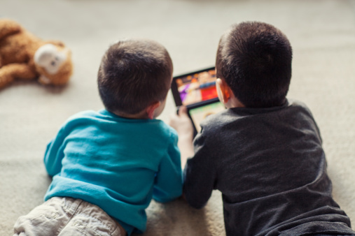 two kids play video games