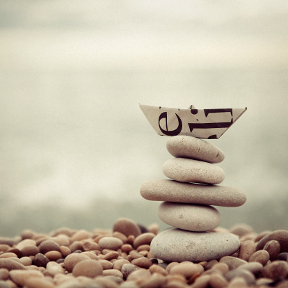 Stones and paper ship